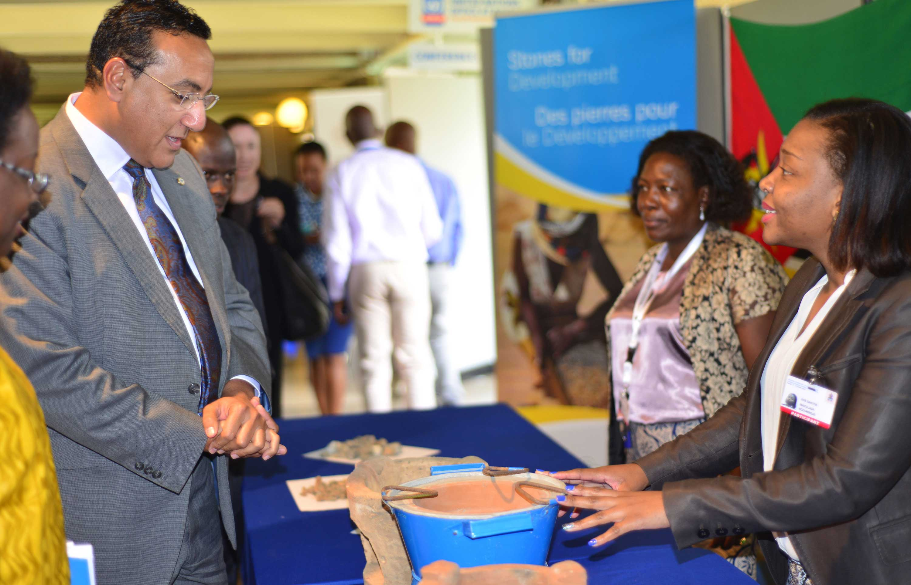 Women miners sponsored to attend Regional Sharefair on Gender Equality in the Extractive Industries demonstrating clay mining methods to H. E Najib Balala, Kenyan Cabinet Secretary of Mining.